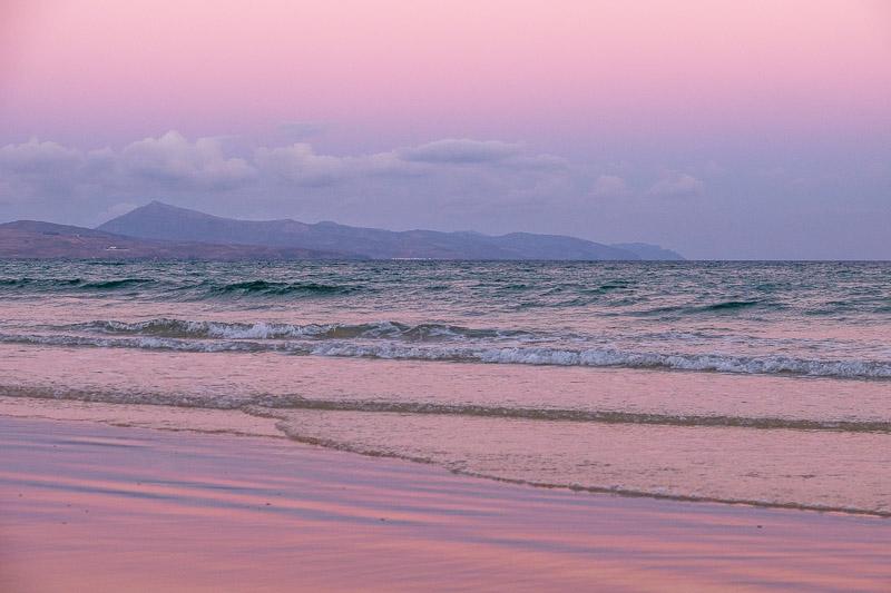Fototipps für Strandaufnahmen Rosa Stimmung zu Sonnenaufgang