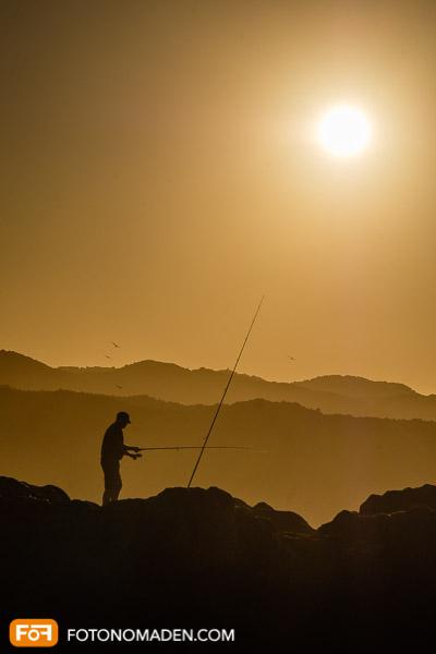 Silhouette Angler bei Sonnenuntergang